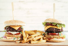 Burgers and French fries Royalty Free Stock Images