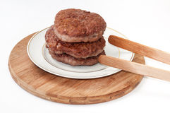 Burgers fried and served on a plate Royalty Free Stock Photo