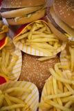 Burgers and fries Stock Photos