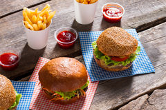 Burgers and fries with sauce. Stock Image