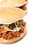 Burgers with grated cheese and pickles Stock Image