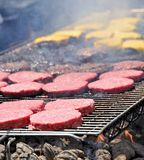 Burgers on the grill Royalty Free Stock Images