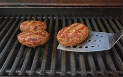 Burgers on grill Royalty Free Stock Image
