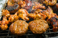Burgers on a grill. Beef burgers on a barbecue grill Royalty Free Stock Photography