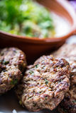 Burgers. Grill burgers. Minced burgers. Roasted burgers with grilled vegetable and herb decoration. Minced meat grilled in a hotel Royalty Free Stock Photos