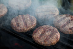 Burgers on a grill Stock Photography