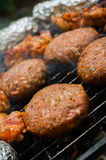 Burgers on a grill Stock Images