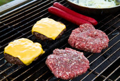 Burgers and Hot Dogs on Grill Stock Photo