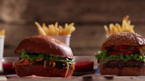 Burgers with sauce and fries. stock footage