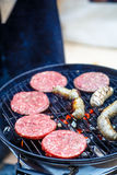 Burgers and sausages for hot dogs Stock Photography