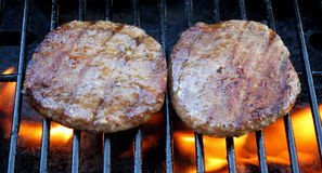 Burgers Sizzling On The Grill Stock Photo