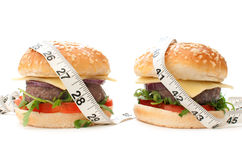 Burgers with tape measure Stock Photography
