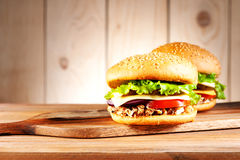 Burgers with turkey, cheese and vegetables Royalty Free Stock Images