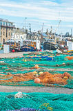 Burghead harbor with fishing boats. Burghead Harbor on Scottish East Coast Tourist Trail with trawlers in port and nets drying stock photography