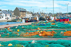Burghead harbor with fishing boats. Burghead Harbor on Scottish East Coast Tourist Trail with trawlers in port and nets drying royalty free stock images