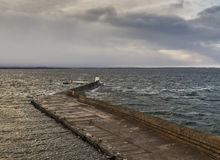 Burghead's Pier in an extreme high tide. Royalty Free Stock Images