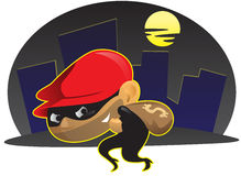 Burglar. In black suit wearing red hat in the dark night Royalty Free Stock Photography