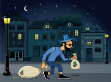 Burglar. Illustration of a robber or burglar creeping along with his swag bag Stock Photos