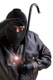 Burglar. With flashlight and crowbar isolated in white Royalty Free Stock Photography