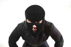 Burglar. In mask looking at camera Royalty Free Stock Images