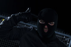 Burglar. Infront a fence at night Stock Photo