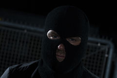 Burglar. Infront a fence at night Stock Image