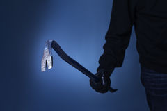 Burglar. Holding a crowbar in his hand Royalty Free Stock Photography