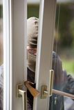 Burglar. Breaks into a residential building Stock Photo