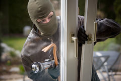 Burglar. Breaks into a residential building Royalty Free Stock Photo