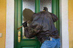 Burglar. Breaks into a residential building Stock Photography