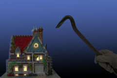 Burglar. House with house-breaker and crowbar at night isolated on black and blue back-ground Royalty Free Stock Images