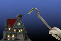 Burglar. House with house-breaker and crowbar at night isolated on black and blue back-ground Royalty Free Stock Photography