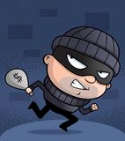 Burglar. A cartoon burglar running with money Stock Photos