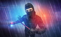 Burglar in action. Burglar in action with colorful concept stock photography