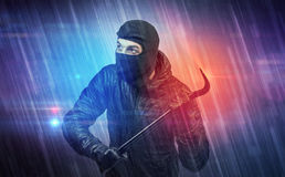 Burglar in action. Royalty Free Stock Image