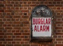 Burglar Alarm. Mounted on brick wall, copy space left stock photography