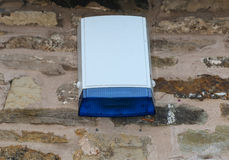 Burglar alarm external ringer bell box with blue flashing light. Burglar security alarm external bell box royalty free stock photos
