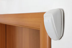 Burglar alarm sensor. Burglar alarm movement sensor on white wall stock photography