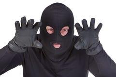 Burglar attack. Against white background stock photos