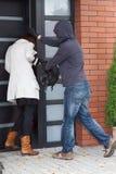 Burglar attacking a woman royalty free stock photos