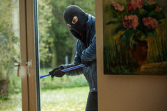 Burglar behind window Royalty Free Stock Photos