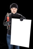 Burglar and billboard. A burglar holding a white banner and a pair of big red clippers royalty free stock image