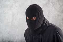 Burglar in black Royalty Free Stock Photography