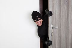 Burglar breaking in an apartment Royalty Free Stock Photography