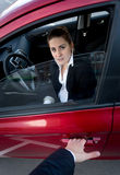 Burglar breaking into the car. Scared woman blocking the door Royalty Free Stock Photography