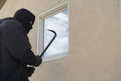 Burglar Breaking Into House Stock Photos