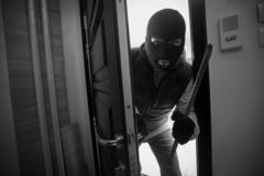 Burglar breaking in a house with crowbar royalty free stock photography