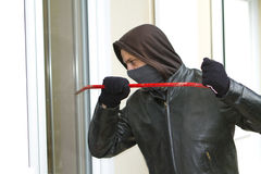 Burglar breaking in a house Royalty Free Stock Photo