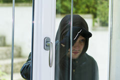 Burglar breaking in a house Royalty Free Stock Photos