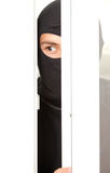 Burglar breaking into a house through window Stock Photography